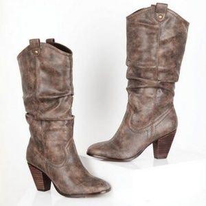 Report• Rosabella cowboy boot